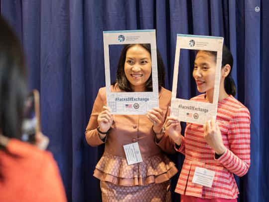 Attendees at the IVLP 80th launch event take photos to share online using the hashtag #FacesOfExchange