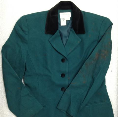 This green suit was worn by Ambassador Prudence Bushnell on the day of the August 7, 1998, terrorist attack on U.S. Embassy Nairobi, Kenya. The bloodstained jacket symbolizes the dangers America's diplomats often face while serving the United States abroad.  Gift of Ambassador Prudence Bushnell