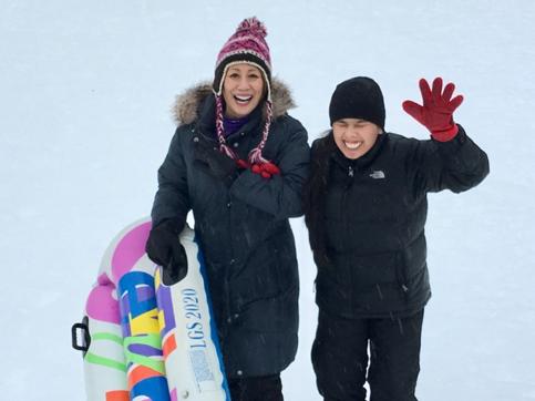 Gina Rose and Seema Tamang enjoying winter activities in Bellevue, Washington