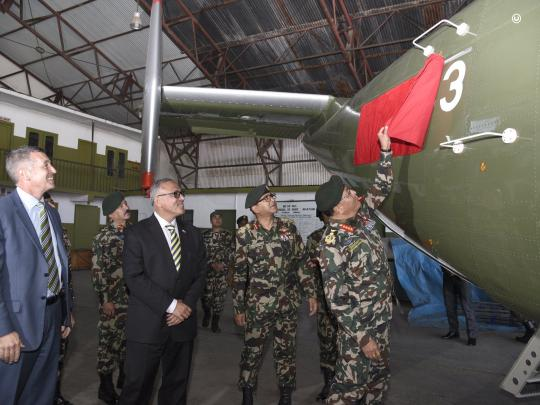 U.S. Ambassador to Nepal Randy Berry joins senior officials to formally hand over the new aircraft at a ceremony at Tribhuvan International Airport (Department of State Photo)