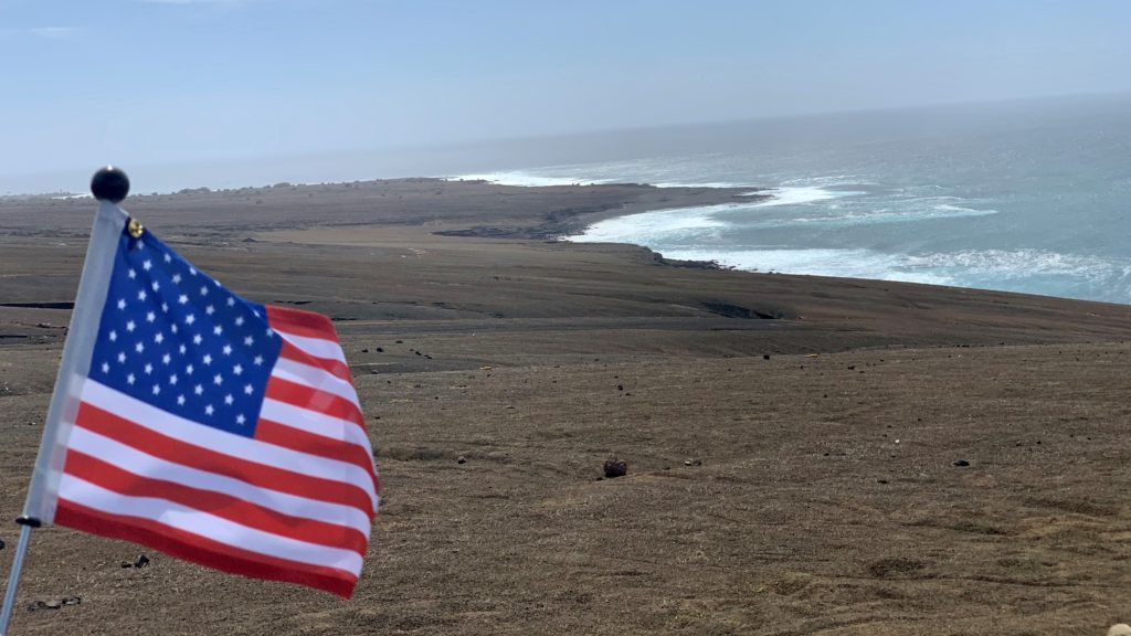 U.S. Flag flying near the shoreline of the island of Sao Nicolau, Cabo Verde.