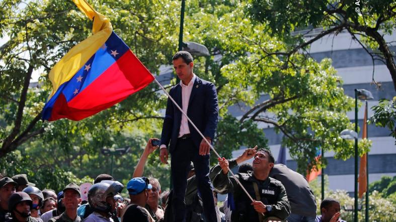 Venezuela's interim president Juan Guaido addresses supporters in Altamira Plaza in Caracas, Venezuela