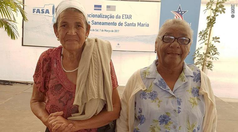 Maria Agusta Fortes (right) is a 77-year-old facilities operator who spends hundreds of dollars of her modest income each year to have the household septic tank emptied. The MCC-funded rehabilitation of the Santa Maria Wastewater Treatment Plant expands water and sanitation services to low-income residents like Fortes, who is looking forward to saving money and time by being connected to the town's sewage system for the first time in her life.