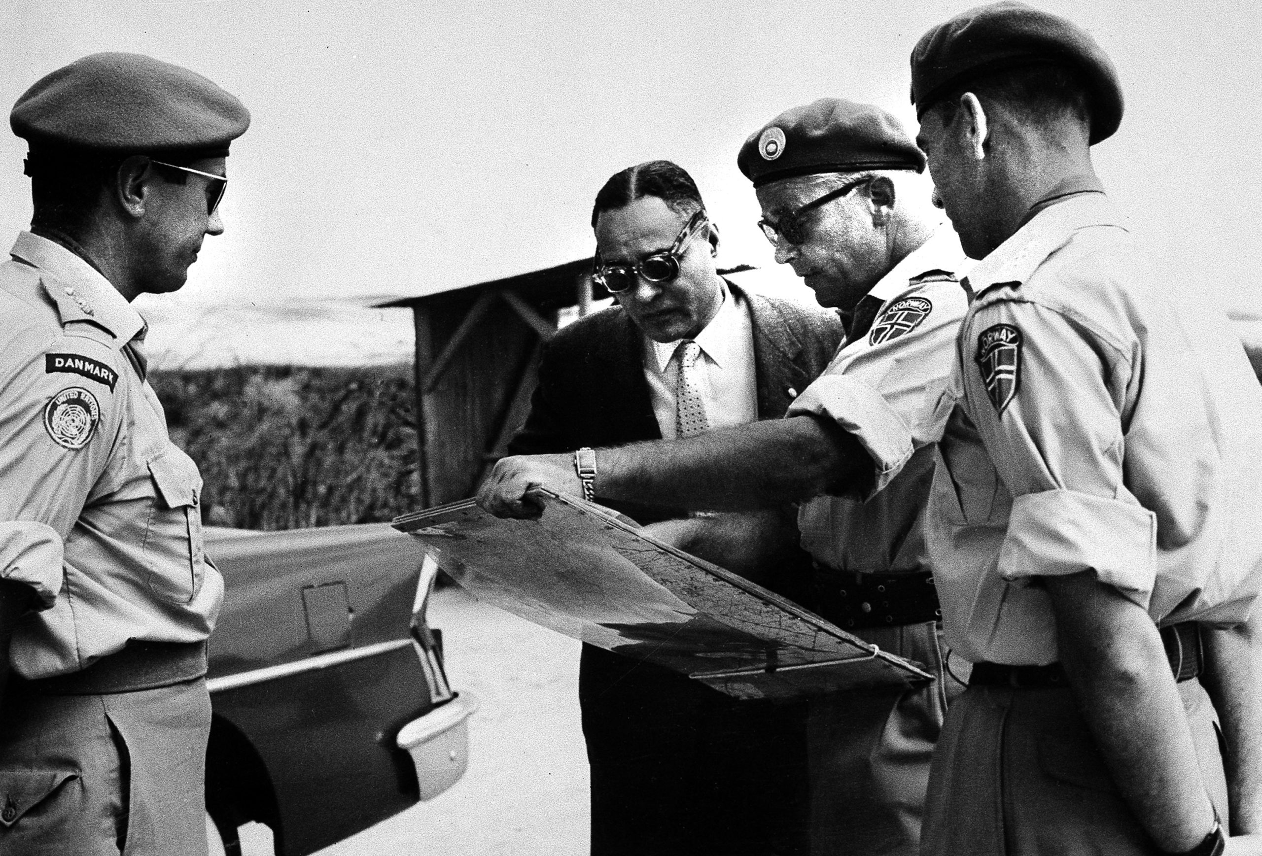 Ralph Bunche with Norwegian officers while visiting a UN Emergency Force observation post.