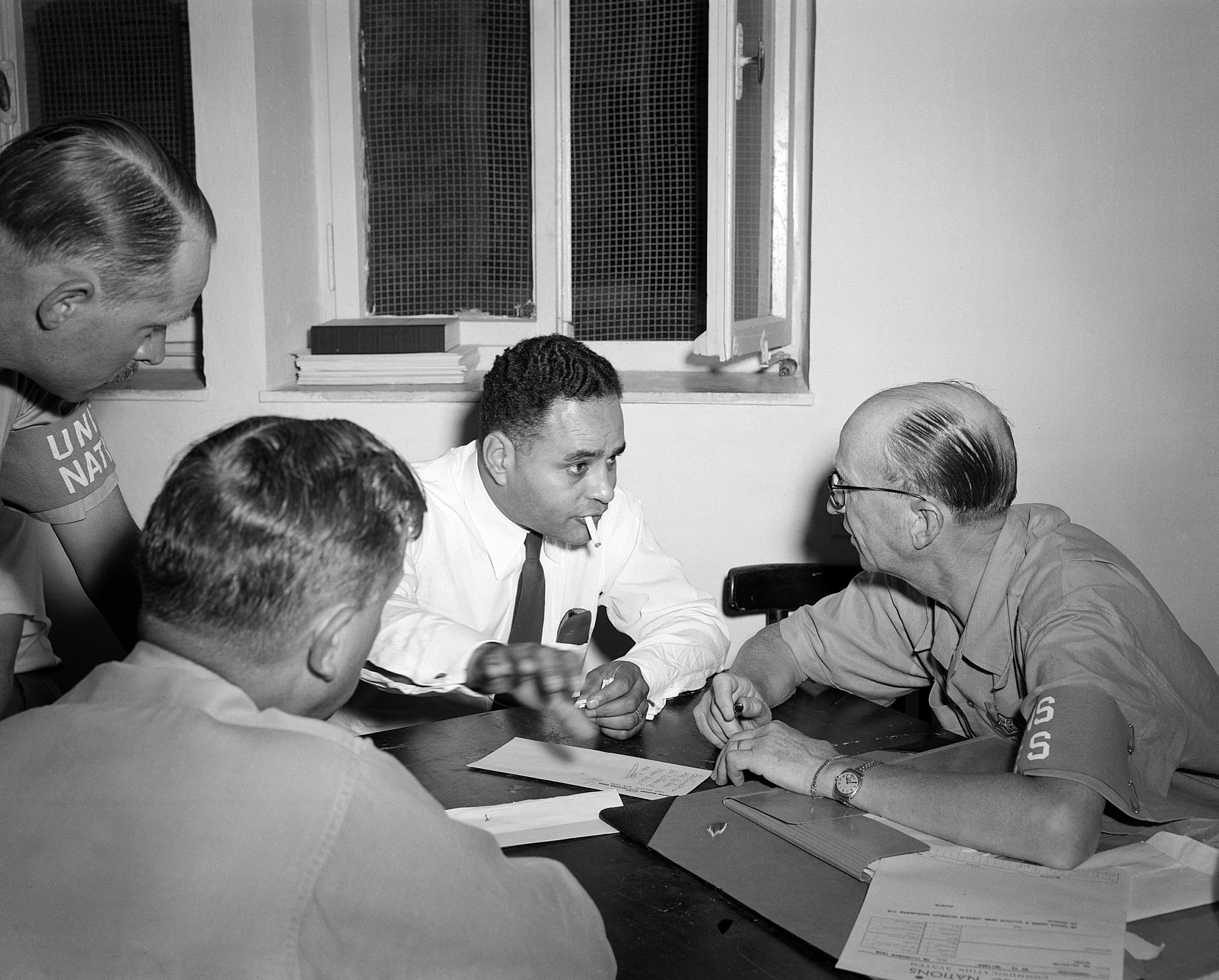 Ralph Bunche at a table negotiating in 1949.