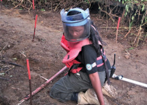 A deminer in DRC clears a lane. Photo courtesy of DCA.