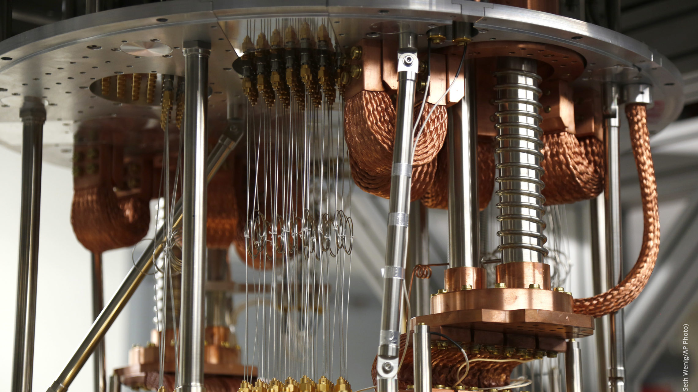 The inner workings of a quantum computer, which require extreme conditions to keep qubits in superposition.