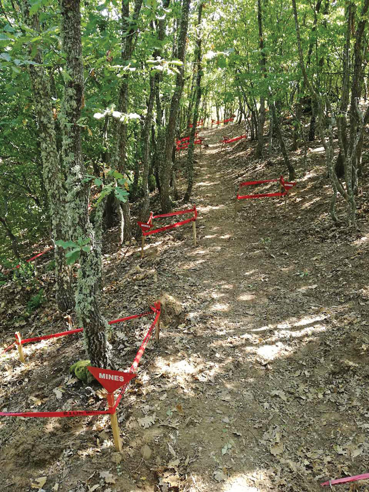 Landmines are marked on a forest path in Serbia. Photo courtesy of ITF.