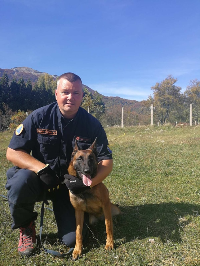 Trainer Alden Ćesko and his canine companion pose after a training session. The MDD was donated by the Marshall Legacy Institute to the Mine Detection Dog Center in Bosnia and Herzegovina. (Photo courtesy of the Marshall Legacy Institute)