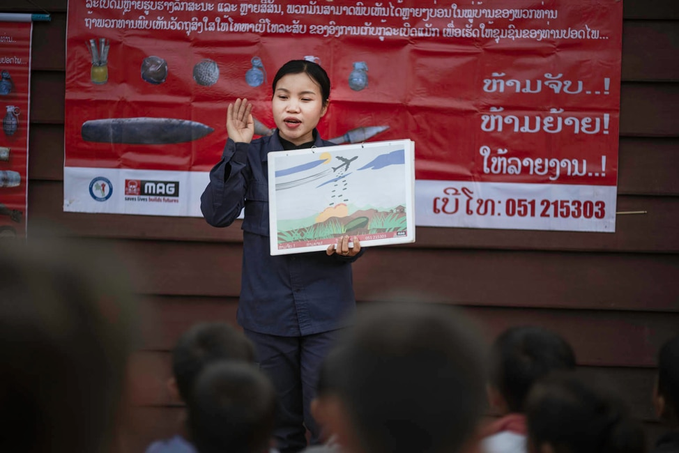 Personnel from @MAGsaveslives provide Mine Risk Education to children in Laos to help them recognize deadly unexploded ordnance. Photo courtesy of the Mines Advisory Group.