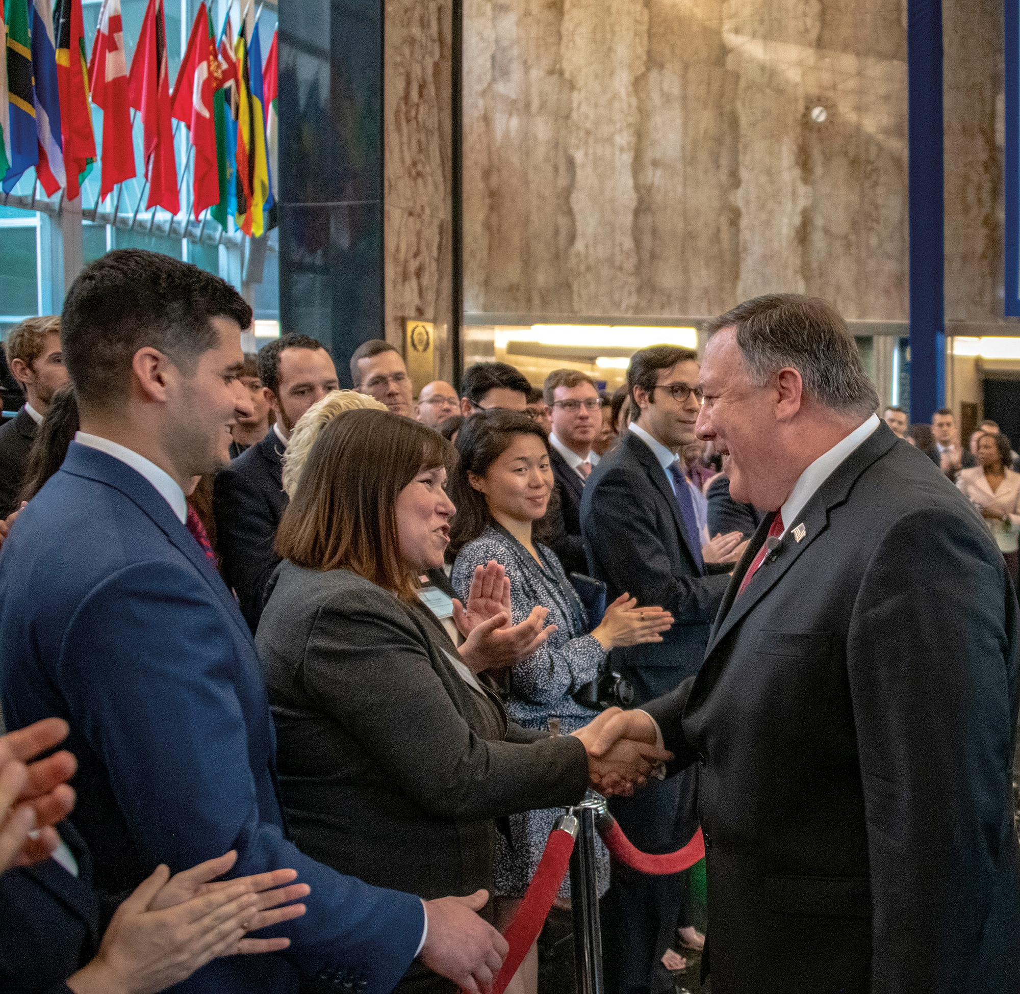 """Photo showing Secretary Pompeo shaking hands with State Department employees after delivering remarks on """"One Team, One Mission, One Future: Introducing our Ethos"""" in Washington, D.C., April 26, 2019. [Department of State]"""