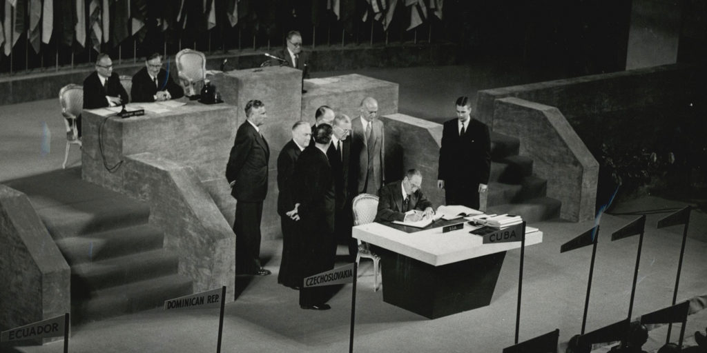 Photo showing Secretary of State Dean Acheson signing the Treaty of Peace with Japan. The treaty officially ended World War II and set the terms of peace with Japan. Forty-nine nations signed the Treaty of Peace with Japan in San Francisco, California, September 8, 1951. [Department of State]
