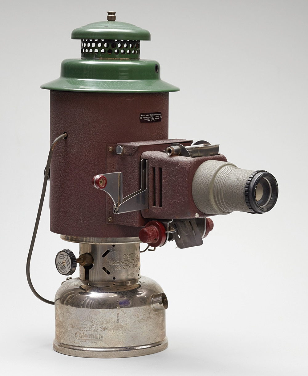 Photo showing a 1950s kerosene-powered slide projector from the U.S. Embassy in Singapore. Diplomats used it to show slides or film strips in areas with limited or no electricity. [Department of State]