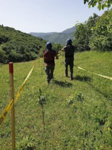 Two deminers leaving a minefield after their work is completed for the day (MDDC photo)
