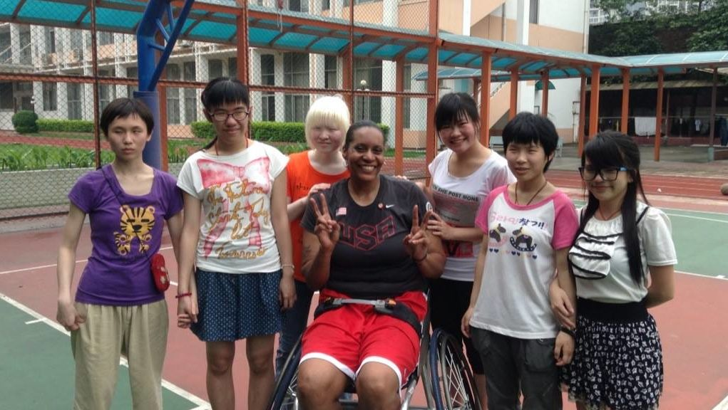 Dr. Andrea Woodson-Smith poses for a photo with a group of students in China.
