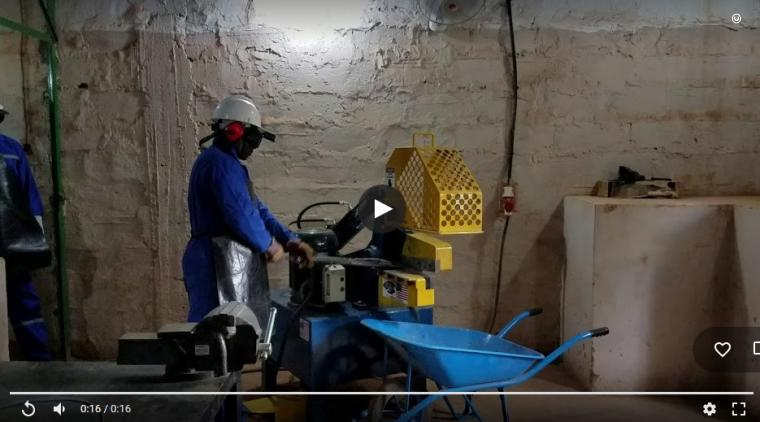 A Nigerien soldier uses the hydraulic shear donated by the United States to cut a decommissioned weapon. (Department of State video)