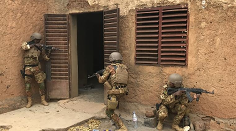 Malian BAFS soldiers clearing a house.