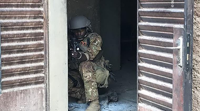 BAFS soldier pulling security during an operation.