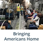 """Bringing Americans Home"" subheader with photo of Embassy Panama City Staff Assist U.S. Citizens Returning Home (Flickr, State Department Photo)"