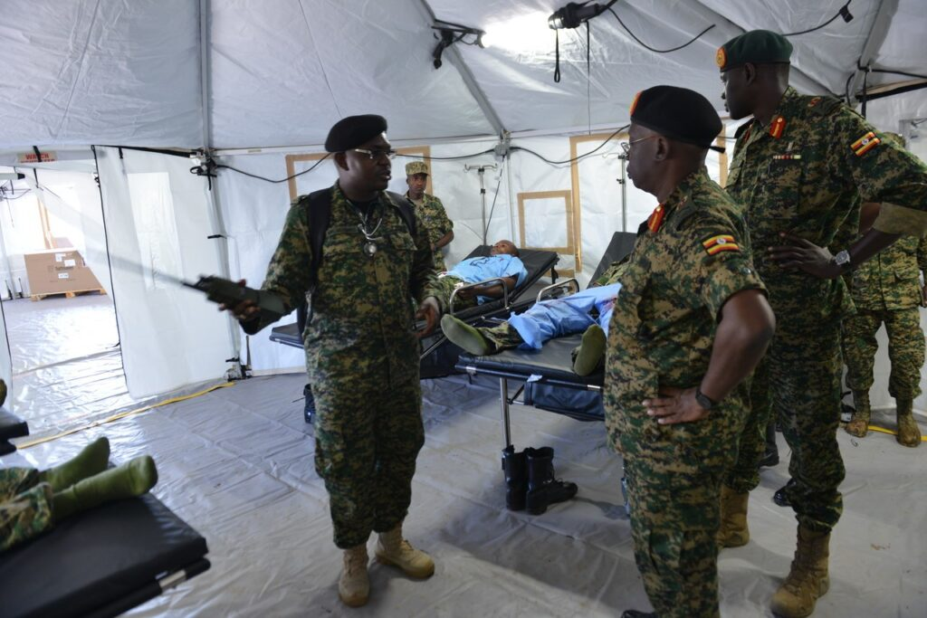 Uganda Peoples' Defence Force medical staff briefs senior officers on the layout of a U.S.-provided United Nations-standard Level 2 expeditionary hospital facility at the Uganda Rapid Deployment Capabilities Center in Jinja, Uganda during a 2019 demonstration (Photo courtesy of U.S. AFRICOM)