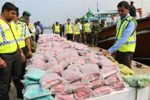 Sri Lankan law enforcement personnel unload seized narcotics (U.S. Department of State photo)