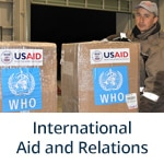 """International Aid and Relations"" subheading with photo of Shipment of personal protective equipment, donated by USAID, arrived in Dushanbe, Tajikistan on March 9, 2020 to assist with in-country COVID-19 detection and prevention Photo Credit: Sayora Khalimova, USAID/Central Asia"