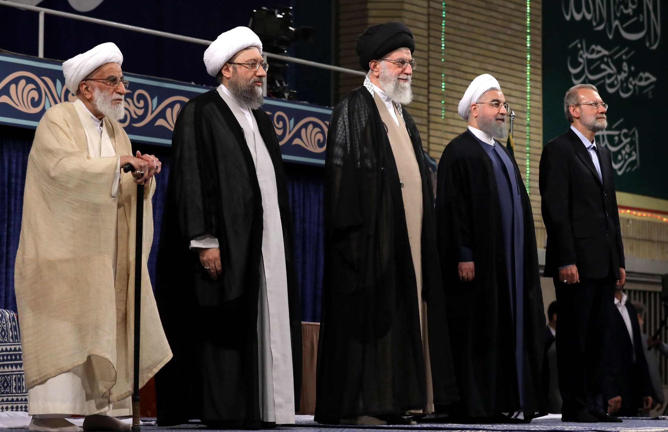 In this picture released by official website of the office of the Iranian supreme leader, Supreme Leader Ayatollah Ali Khamenei, center, President Hassan Rouhani, second right, parliament speaker Ali Larijani, right, judiciary chief Sadeq Larijani, second left, and head of the Assembly of Experts and secretary of Guardian Council Ahmad Jannati listen to the national anthem at the start of the official endorsement ceremony of President Rouhani in Tehran, Iran, Thursday, Aug. 3, 2017. (Office of the Iranian Supreme Leader via AP)
