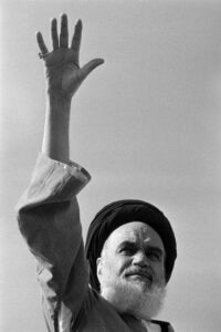 Ayatollah Ruhollah Khomeini salutes the crowd which gathered in Qom to greet the Iranian spiritual leader on Nowruz, Iran's new year feast, March 21, 1979 (AP Photo/Randy G. Taylor)