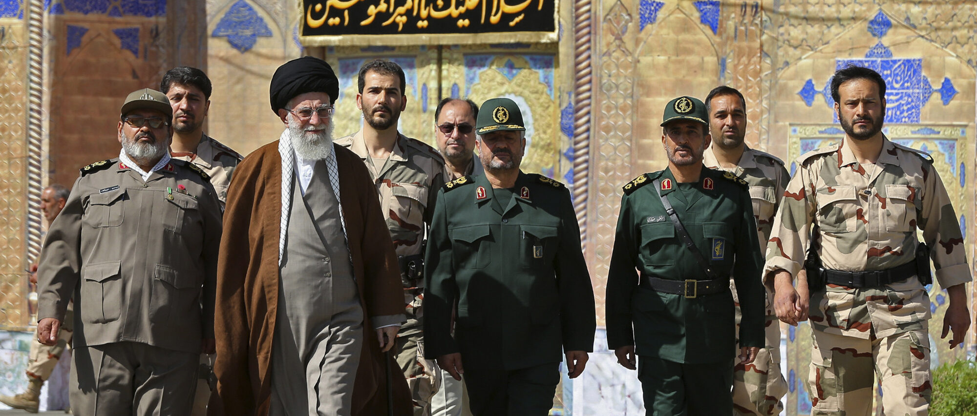 In this picture released by an official website of the office of the Iranian supreme leader on Wednesday, May 20, 2015, Supreme Leader Ayatollah Ali Khamenei, second left, attends a graduation ceremony of Revolutionary Guard officers in Tehran, Iran, as he is accompanied by Chief of the General Staff of Iran's Armed Forces, Hasan Firouzabadi, left, and Revolutionary Guard commander Mohammad Ali Jafar, center. Iran's supreme leader vowed Wednesday he will not allow international inspection of Iran's military sites or access to Iranian scientists under any nuclear agreement with world powers. (Office of the Iranian Supreme Leader via AP)