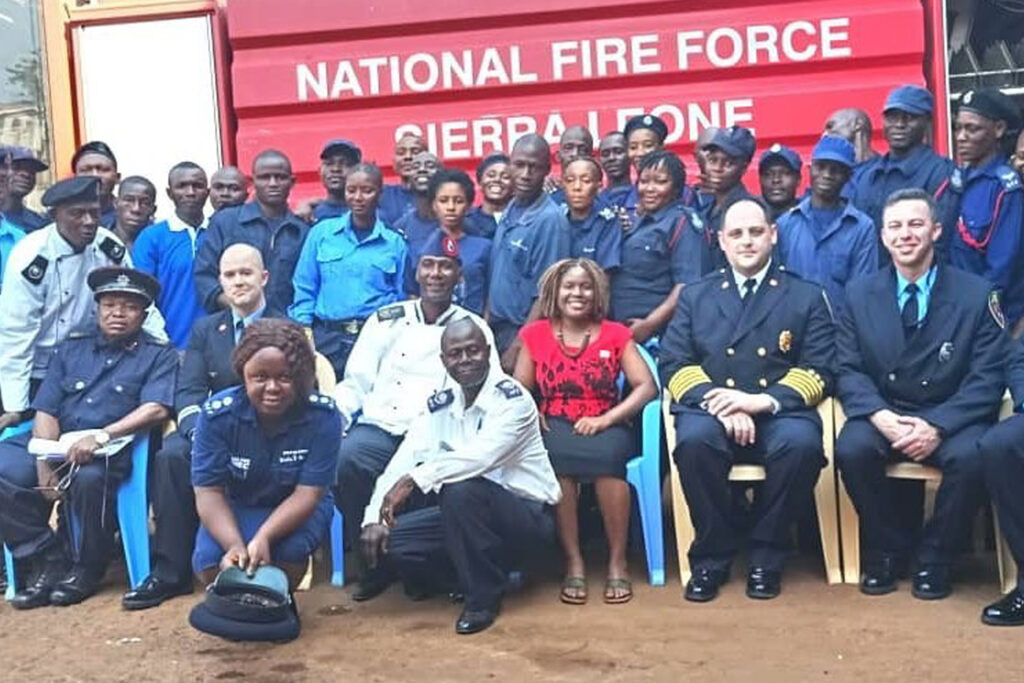 Members of the Sierra Leone National Fire Force, Embassy Freetown personnel, and firefighters with the Bloomington, Indiana, Fire Department take a group photo after completing a week-long training program sponsored by the Young African Leadership Initiative, Freetown, Sierra Leone, February 2019.(Photo courtesy of Bloomington Fire Department)