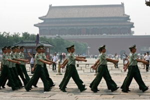 Chinese soldiers pass a sqare at the entrance to the Forbidden City in Beijing on Wednesday, August 16, 2006. Original construction of the Forbidden City began in 1406 AD requiring an estimated 3 million workers and the costs nearly bankrupted the Ming Dynasty under its third emperor Zhu Di. (KEYSTONE/Alessandro Della Bella) === , ===