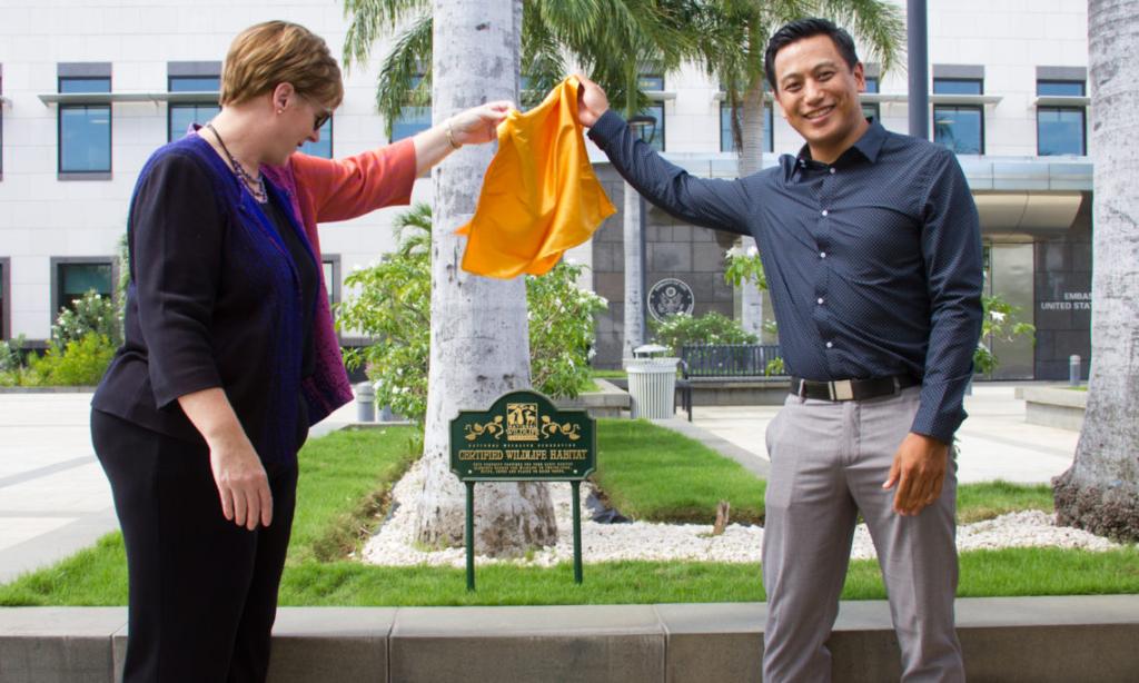 Ambassador Dogu unveils Embassy Managua's Wildlife Habitat certification in 2017 (Photo courtesy of the U.S. Embassy Managua)