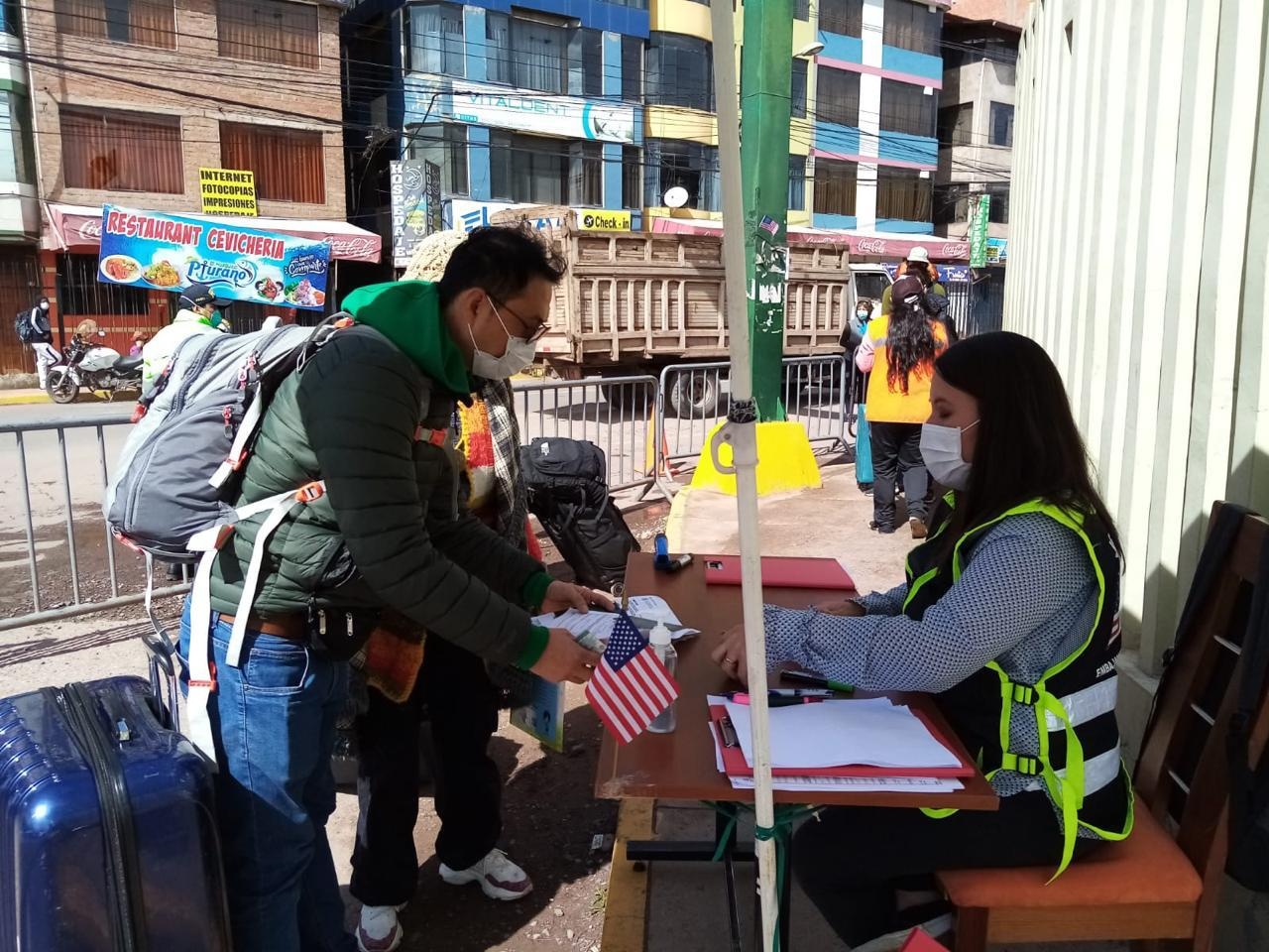 U.S. Consular Agent Marian Nguyen helps to process U.S. citizens during the evacuations (Photo courtesy of Marian)