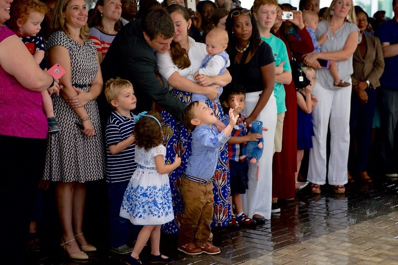The child of a staffer from U.S. Embassy Abuja revels in a downpour as the U.S. Secretary of State addresses Embassy employees and their family members on August 24, 2016, at the U.S. Embassy in Abuja, Nigeria. [State Department Photo/ Public Domain]