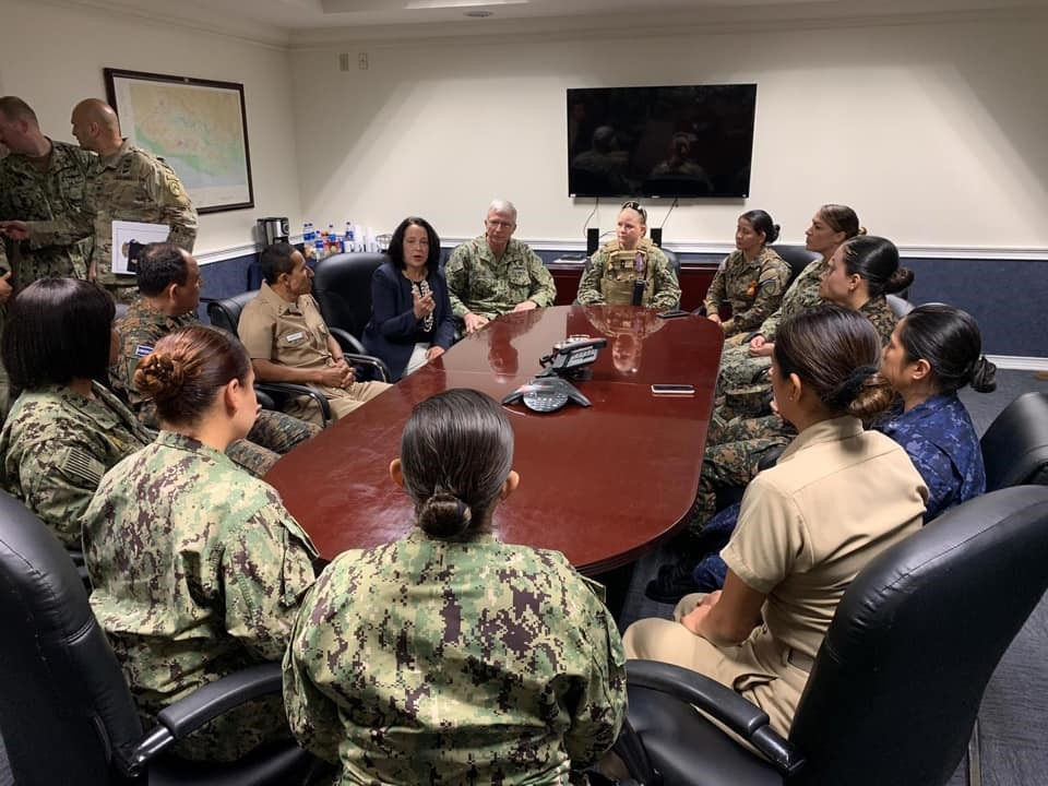 The author, Ambassador Manes, joined by Rene Francis Merino, Minister of Defense of El Salvador and Admiral Craig Faller, Commander, U.S. Southern Command (SOUTHCOM), meets with a group of active duty women serving in U.S. and Salvadoran security forces. (Photo courtesy of U.S. SOUTHCOM)