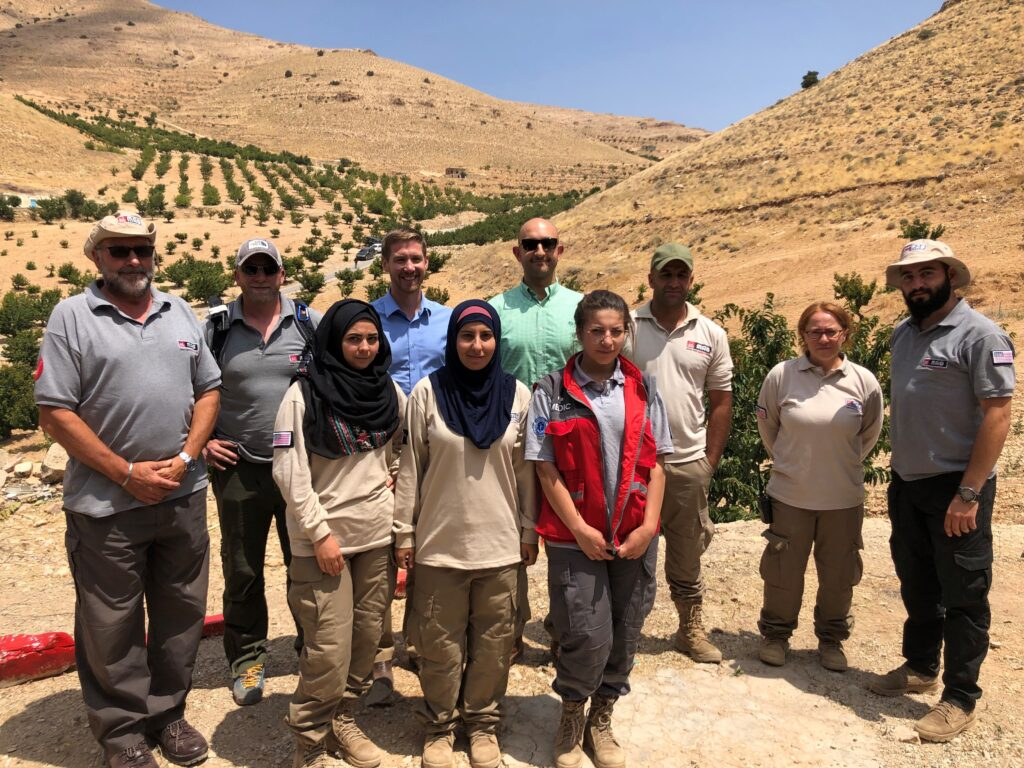 Embassy Beirut Official and the author with MAG staff in Arsal (Department of State photo)