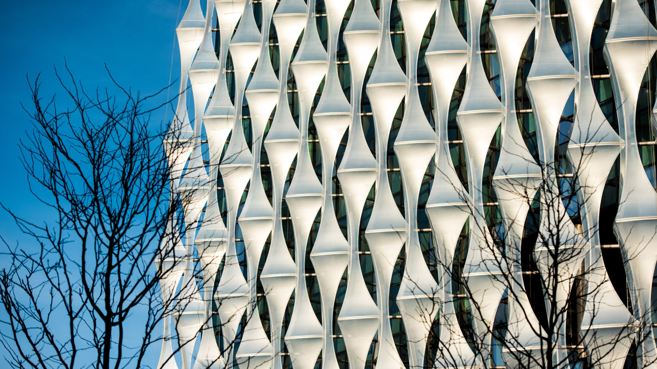 "The ""sails""along the sides of the New London Embassy glow as they catch the afternoon sun (U.S. Embassy London photo)"