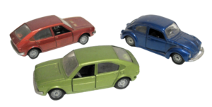 Close-up picture of three toy cars.