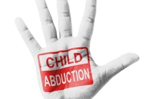 Open hand raised, Child Abduction sign painted, multi purpose concept - isolated on white background [Shutterstock]