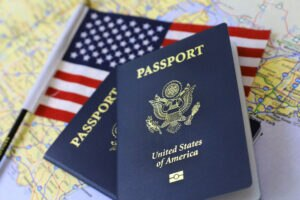 Passport and American flag [Shutterstock]