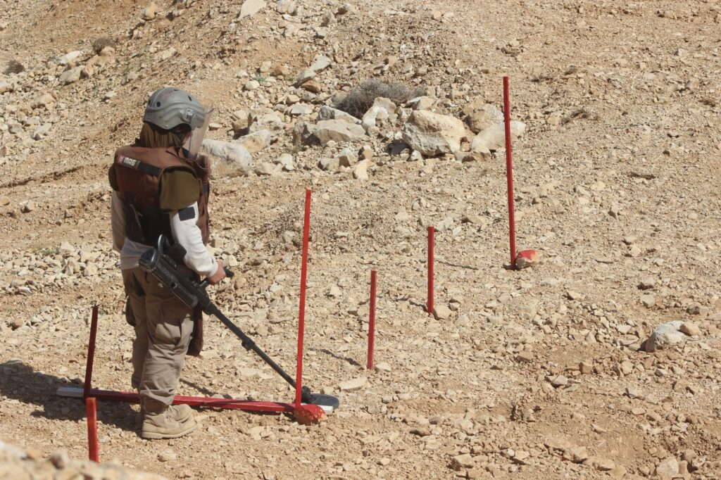 Zahraa searches for explosive hazards buried by extremists in Arsal. (Photo courtesy of MAG)