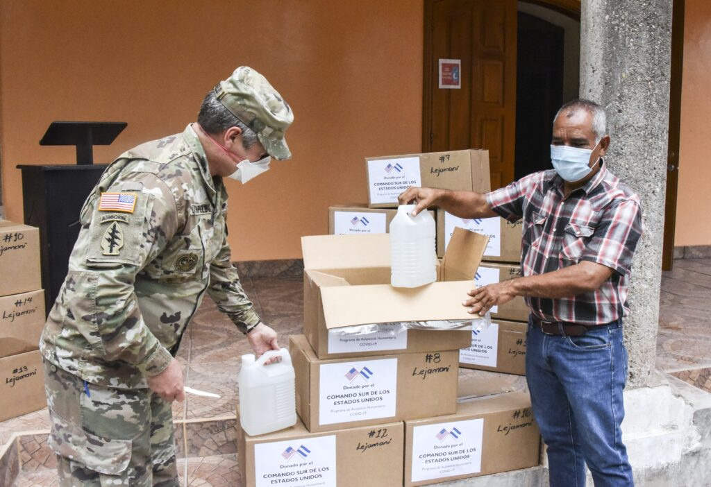 U.S. Army Col. John Litchfield, Joint Task Force-Bravo commander, unboxes medical supplies with Mr. Francisco Mendez, Mayor of Lejamaní, a municipality in the department of Comayagua, Honduras, August 11, 2020. The donation was part of four different deliveries in the departments of La Paz and Comayagua, which included personal protective equipment and medical supplies, provided under U.S. Southern Command's Humanitarian Assistance Program to aid local health professionals in the fight against COVID-19 in the region. (Photo by Maria Pinel, Joint Task Force-Bravo)