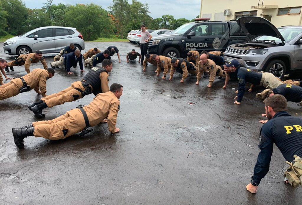 DSS Special Agent Adrian Diaz (left, in suit) completes push-ups – in a suit – during a workout with some Brazilian law enforcement partners.