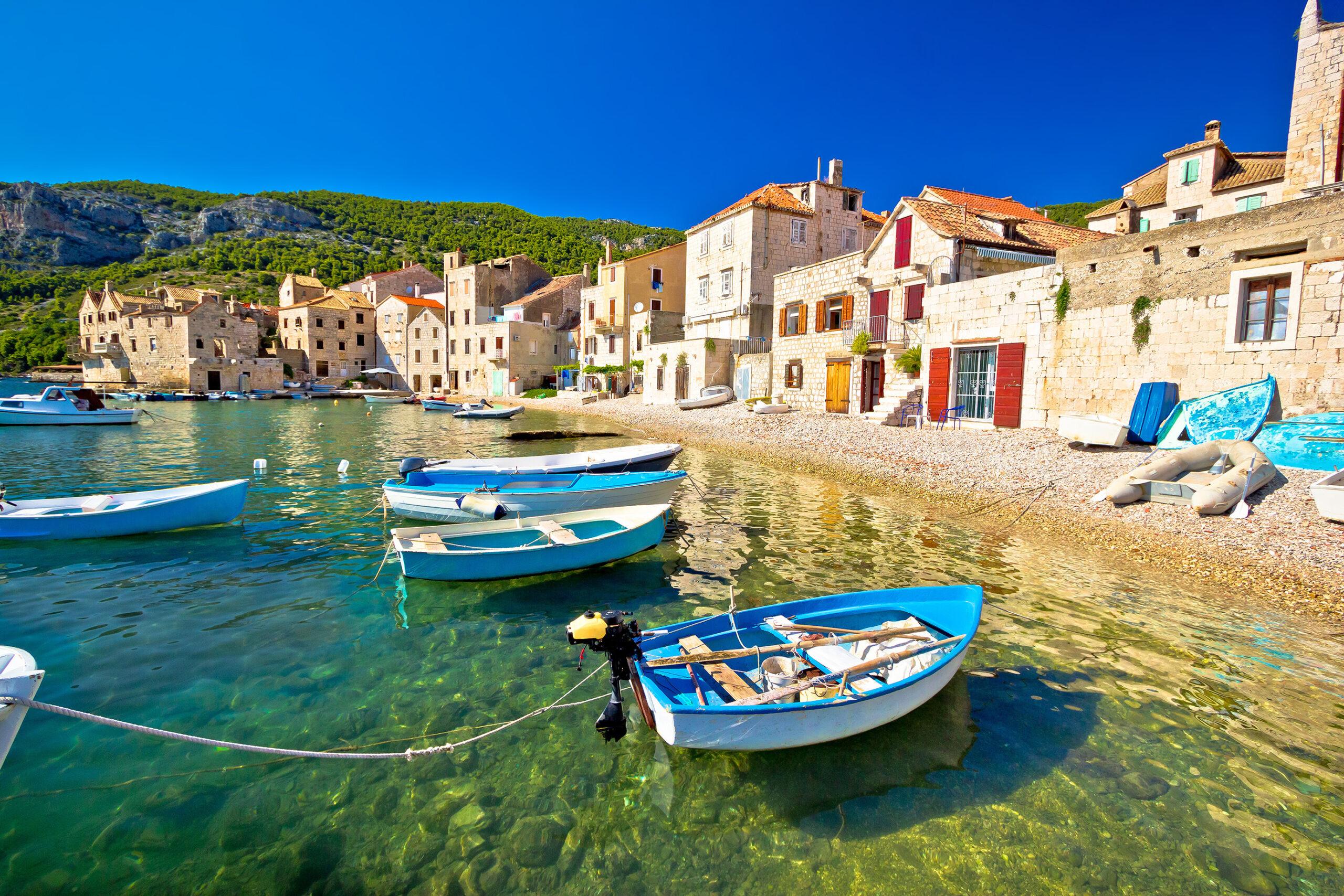 Scenic beach in Komiza village waterfront, Island of Vis, Croatia