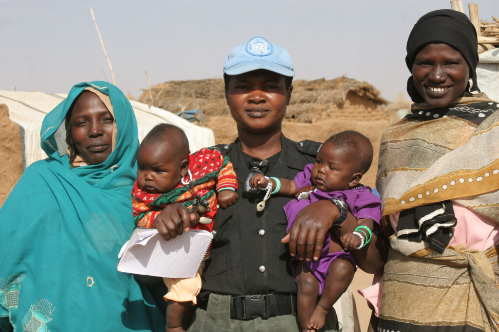 UN Peacekeeping personnel engage with area residents in Darfur (AP Photo)
