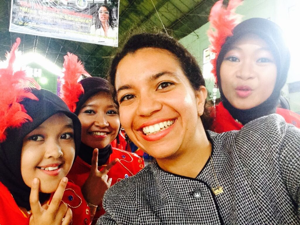 Carolina takes a photo with local students in Surabaya, Indonesia. (Photo courtesy of Carolina Escalera)