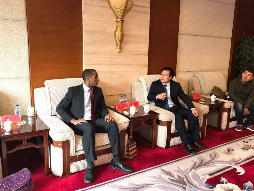 Leland meets with officials in Baishan, China in 2017.