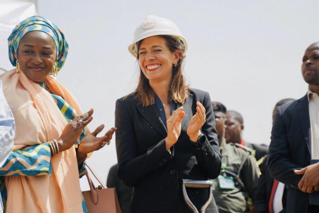 Mira Mehta, center, founder of Tomato Jos, celebrates at a ceremony for Tomato Jos' processing facility in Nigeria. (Photo courtesy of Tomato Jos)