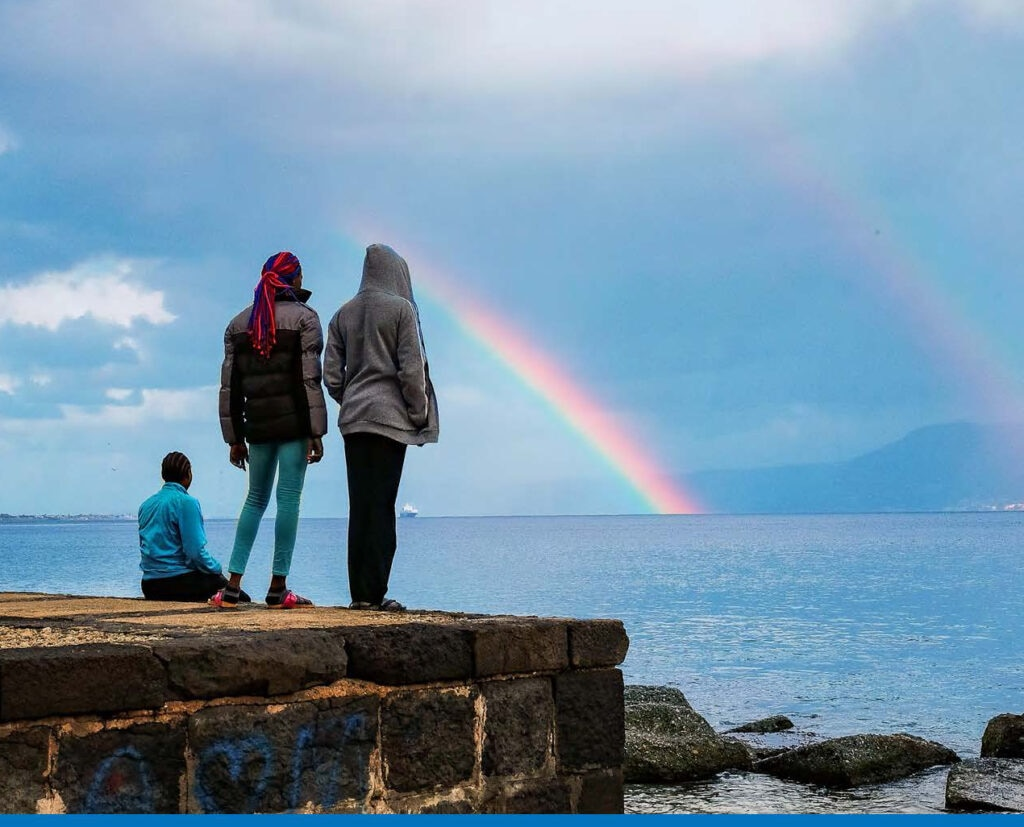 United States Advisory Council on Human Trafficking Annual Report 2017: Cover shows people watching a rainbow.