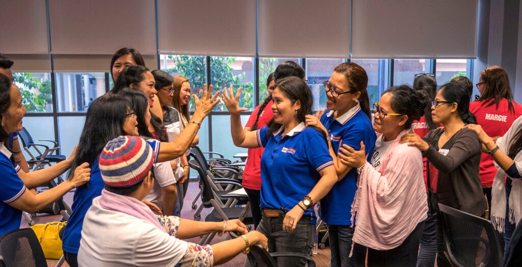 Women celebrating in a training class (Photo Credit: UN Women, Staton Winter)